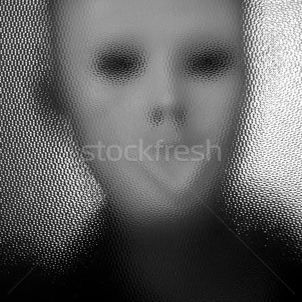 masked figure behind glass Stock photo © sirylok