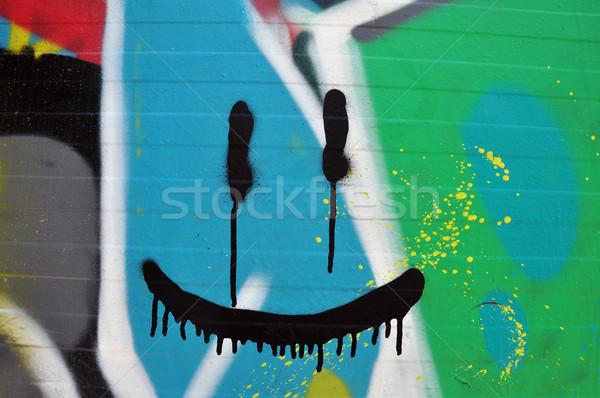 Streszczenie uśmiechnięta twarz ściany kolorowy graffiti twarz Zdjęcia stock © sirylok
