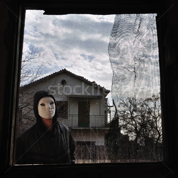 hooded figure threaded window Stock photo © sirylok