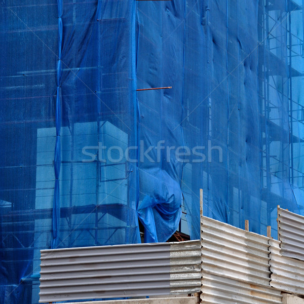 Stock photo: building under debris netting at construction site