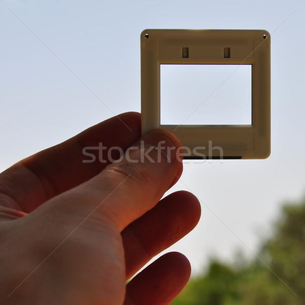 Mão deslizar quadro de imagem lugar próprio Foto stock © sirylok