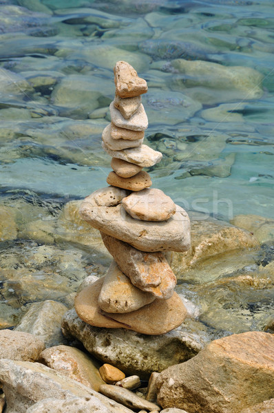 balanced stone structure on rocky shore Stock photo © sirylok