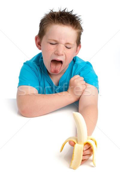 Garçon pas heureux manger banane comme Photo stock © SLP_London