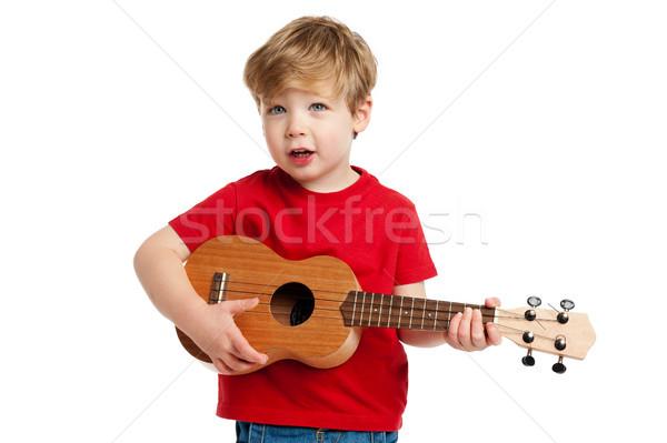 Sevimli erkek oynama gitar şarkı söyleme atış Stok fotoğraf © SLP_London