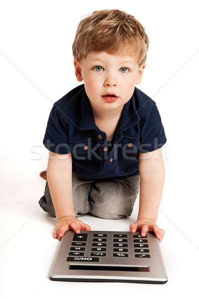 Cute boy counting with calculator. Stock photo © SLP_London