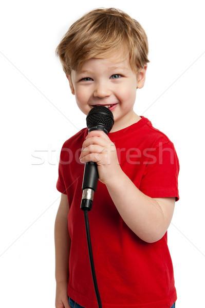 Sevimli erkek şarkı söyleme gülen mikrofon Stok fotoğraf © SLP_London