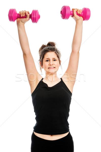 Genç genç kız ağırlıklar asansör pembe Stok fotoğraf © SLP_London