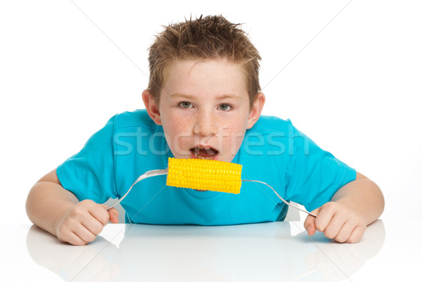 Boy eating corn on cob Stock photo © SLP_London