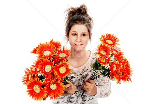 Teenage girl holding two bunches of fake flowers. Stock photo © SLP_London