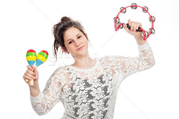 Teenage girl with tambourine and maracas. Stock photo © SLP_London