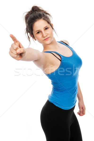 Pretty teenage girl pointing finger at camera. Stock photo © SLP_London
