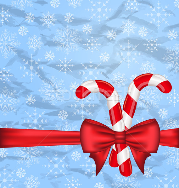Christmas background with gift bow and sweet canes, snowflakes t Stock photo © smeagorl