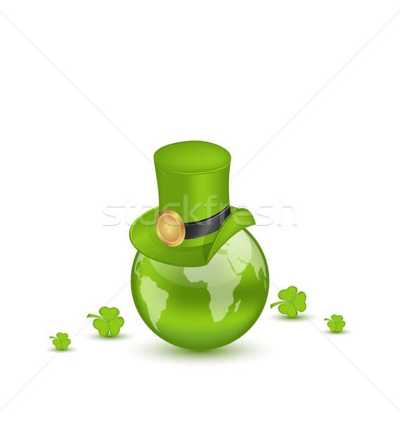 Hat and shamrocks around Globe on St. Patrick's Day Stock photo © smeagorl