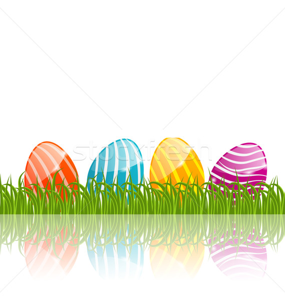 Easter traditional eggs in green grass with empty space for your Stock photo © smeagorl
