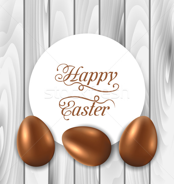 Celebration card with Easter chocolate eggs on wooden grey backg Stock photo © smeagorl