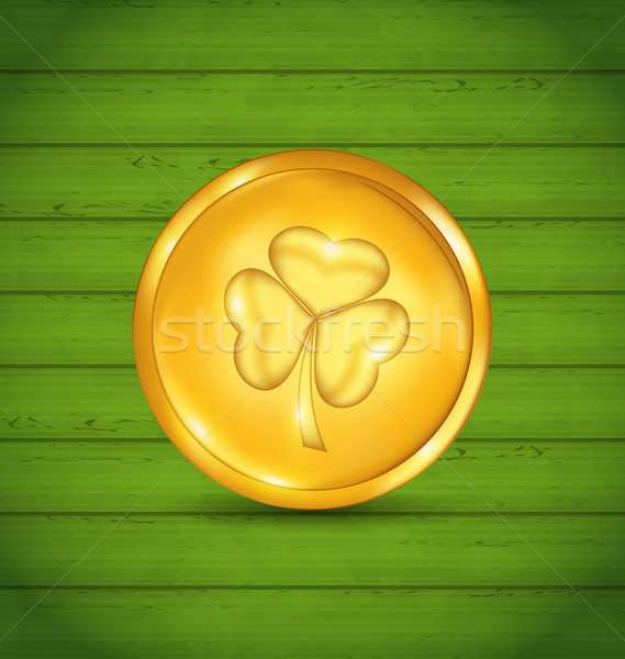 Golden coin with clover on green wooden texture for St. Patrick' Stock photo © smeagorl