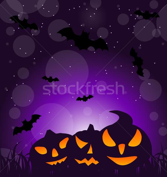 Halloween ominous pumpkins on moonlight background Stock photo © smeagorl