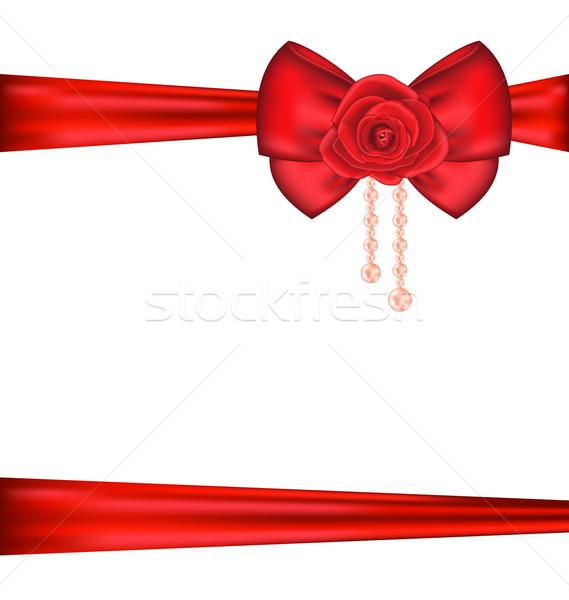 Kırmızı yay gül inciler hediye Stok fotoğraf © smeagorl