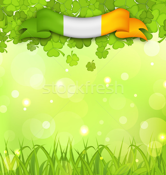 Glowing nature background with shamrocks, grass and Irish flag f Stock photo © smeagorl