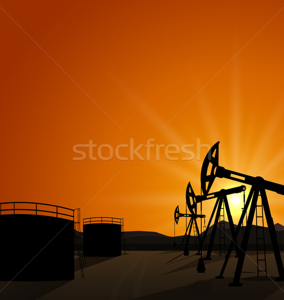 Oil pump jack for petroleum and reserve tanks on sunrise backgro Stock photo © smeagorl