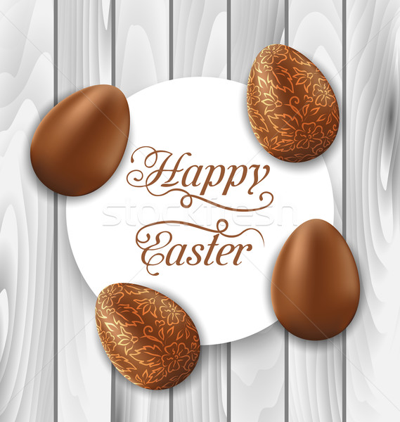 Greeting card with Easter chocolate ornamental eggs on wooden ba Stock photo © smeagorl