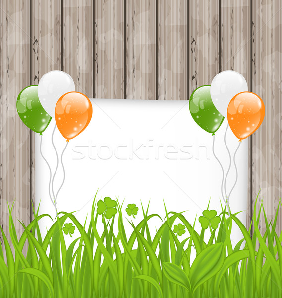 Greeting card with grass and balloons in Irish flag color for St Stock photo © smeagorl