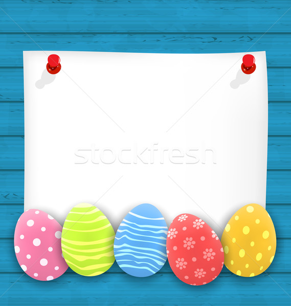 Celebration empty paper card with Easter ornamental eggs on wood Stock photo © smeagorl