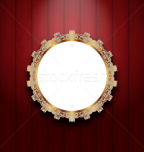 Ornate picture frame on wooden wall  Stock photo © smeagorl