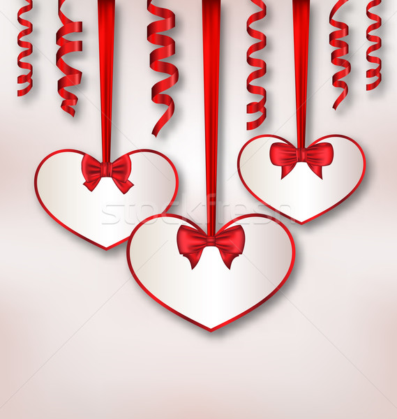 Set card heart shaped with silk ribbon bows and paper serpentine Stock photo © smeagorl