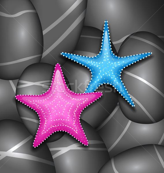 Starfishes among sea pebble stones Stock photo © smeagorl
