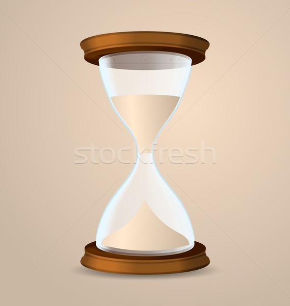 Vintage hourglass isolated on beige background Stock photo © smeagorl