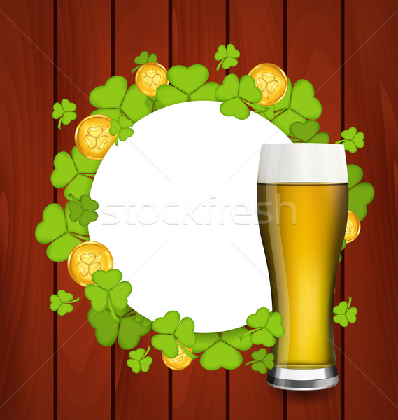 Greeting card with glass of light beer, shamrocks and golden coi Stock photo © smeagorl