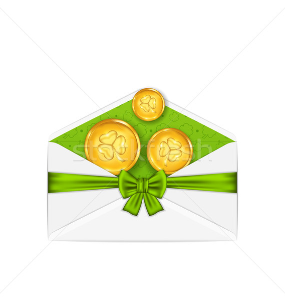 Open white envelope with golden coins and bow ribbon for St. Pat Stock photo © smeagorl