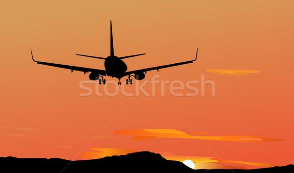 Avion diminuer ciel montagne vitesse noir Photo stock © smeagorl