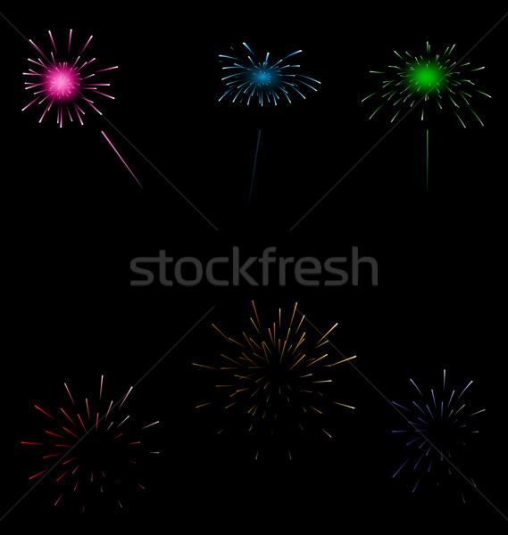 Set colorful fireworks on dark background Stock photo © smeagorl