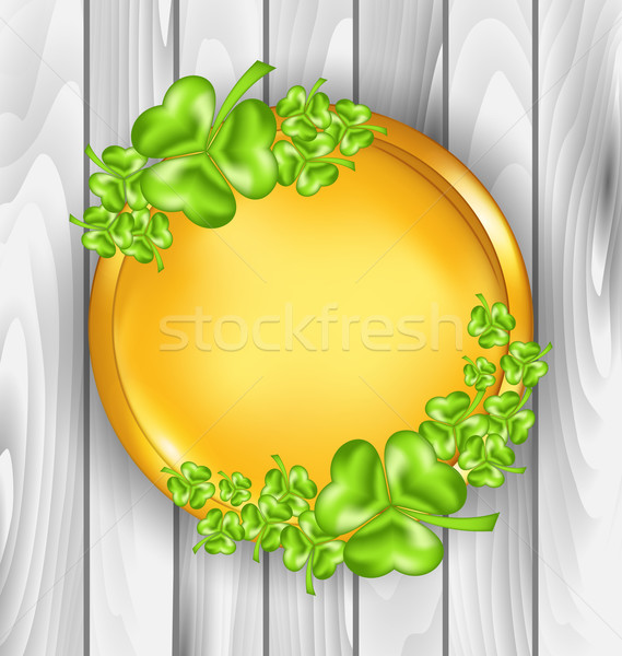 Golden coin with shamrocks. St. Patrick's day symbol, wooden tex Stock photo © smeagorl
