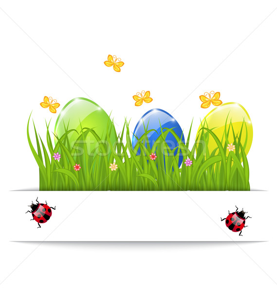 Easter colorful eggs in green grass with space for your text Stock photo © smeagorl