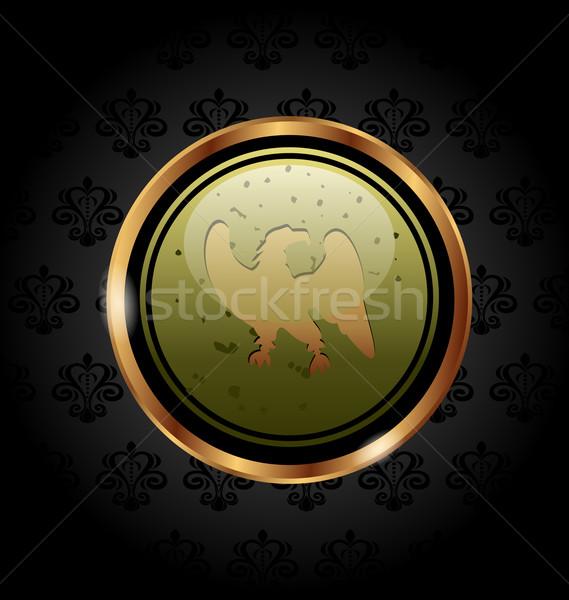 golden medallion with heraldic eagle Stock photo © smeagorl