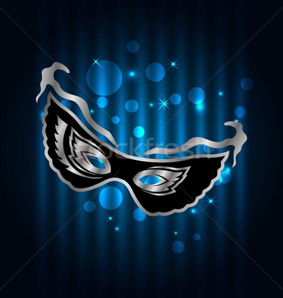 Carnival ornate mask on blue glowing background Stock photo © smeagorl