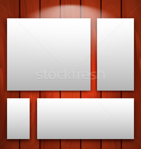 Gallery interior with empty frames on wooden wall with light  Stock photo © smeagorl
