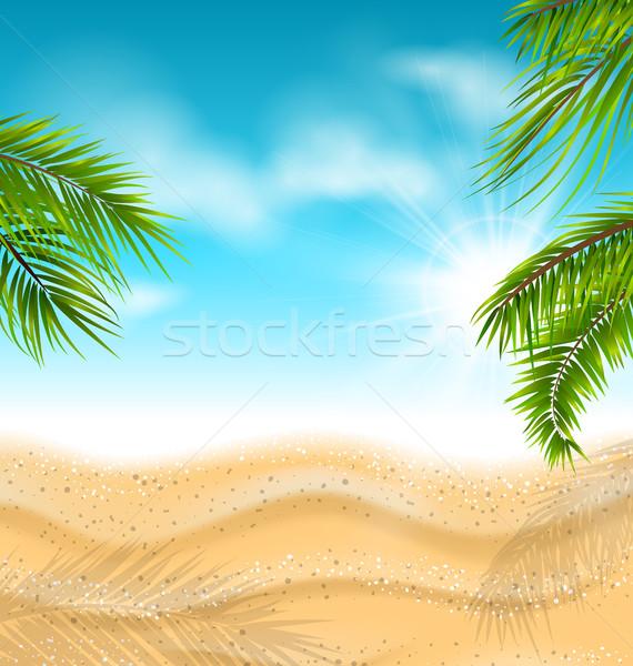 Plage tropicale sable mer feuilles de palmier soleil ciel Photo stock © smeagorl