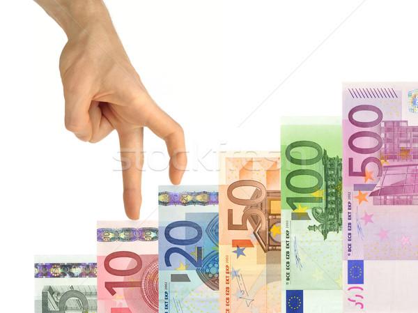 Hand climbing up stairs of money Stock photo © Smileus