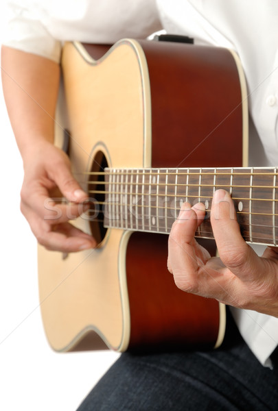 Playing the acoustic guitar Stock photo © Smileus