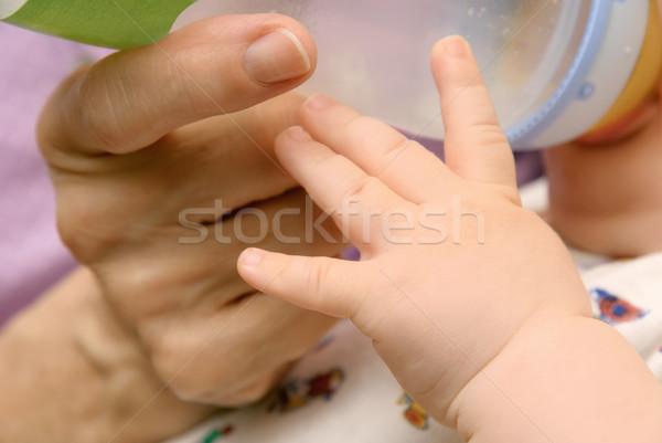 Hands of baby and grandma Stock photo © Smileus