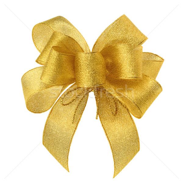 Smart gold bow on white Stock photo © Smileus