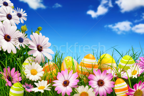 Easter eggs, flowers and the blue sky Stock photo © Smileus