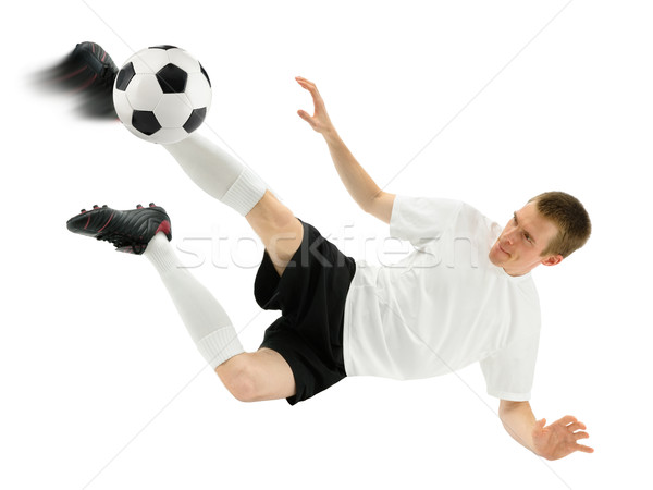 Accomplished soccer player in midair Stock photo © Smileus