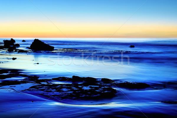 Dusk at the blue sea Stock photo © Smileus