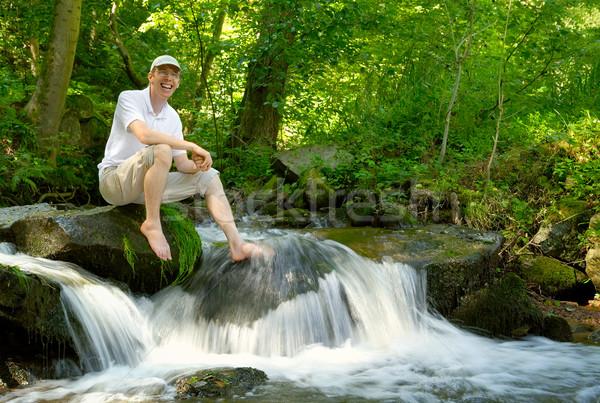 Młody człowiek charakter szczęśliwy posiedzenia piękna Zdjęcia stock © Smileus