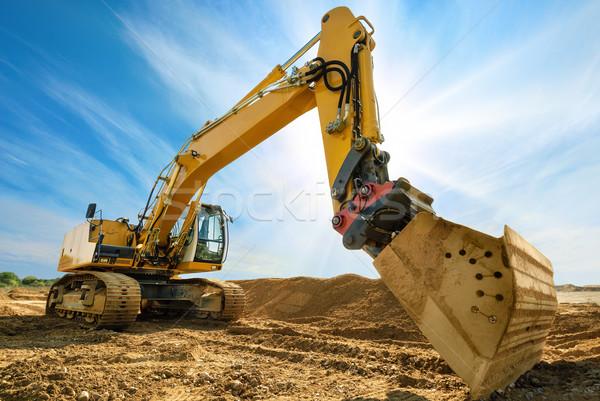Big excavator in front of the blue sky Stock photo © Smileus